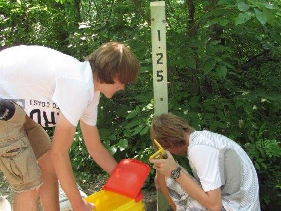 Eagle Scout placing mile markers on trail